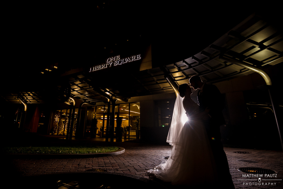 Greenville wedding photographers | bride and groom kissing outside Commerce Club