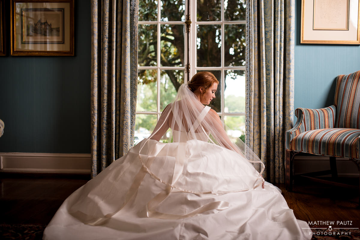 Bride posing in front of a window at The Poinsett Club in Greenville SC