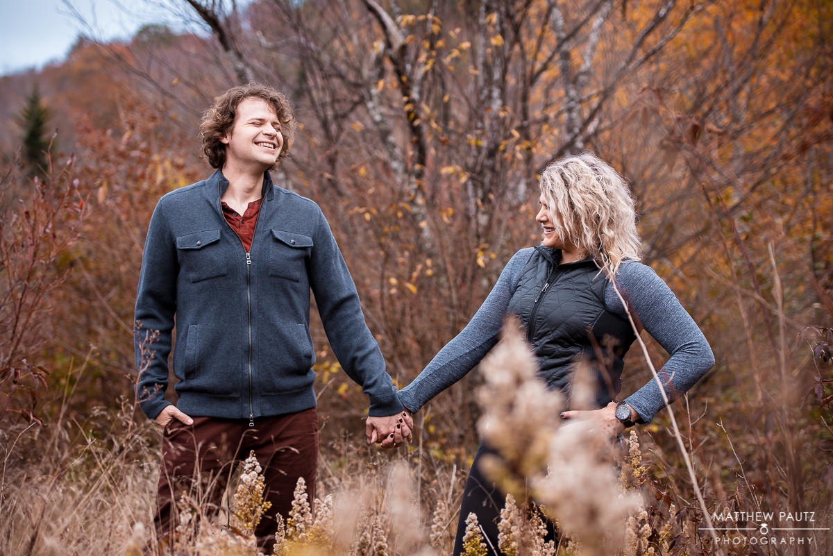 Couple holding hands in the mountains during Fall