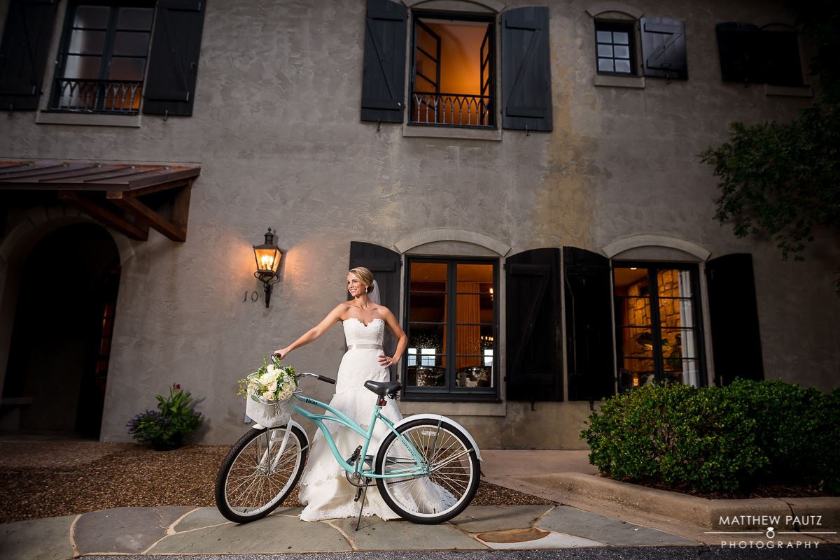 bride with bicycle outside hotel