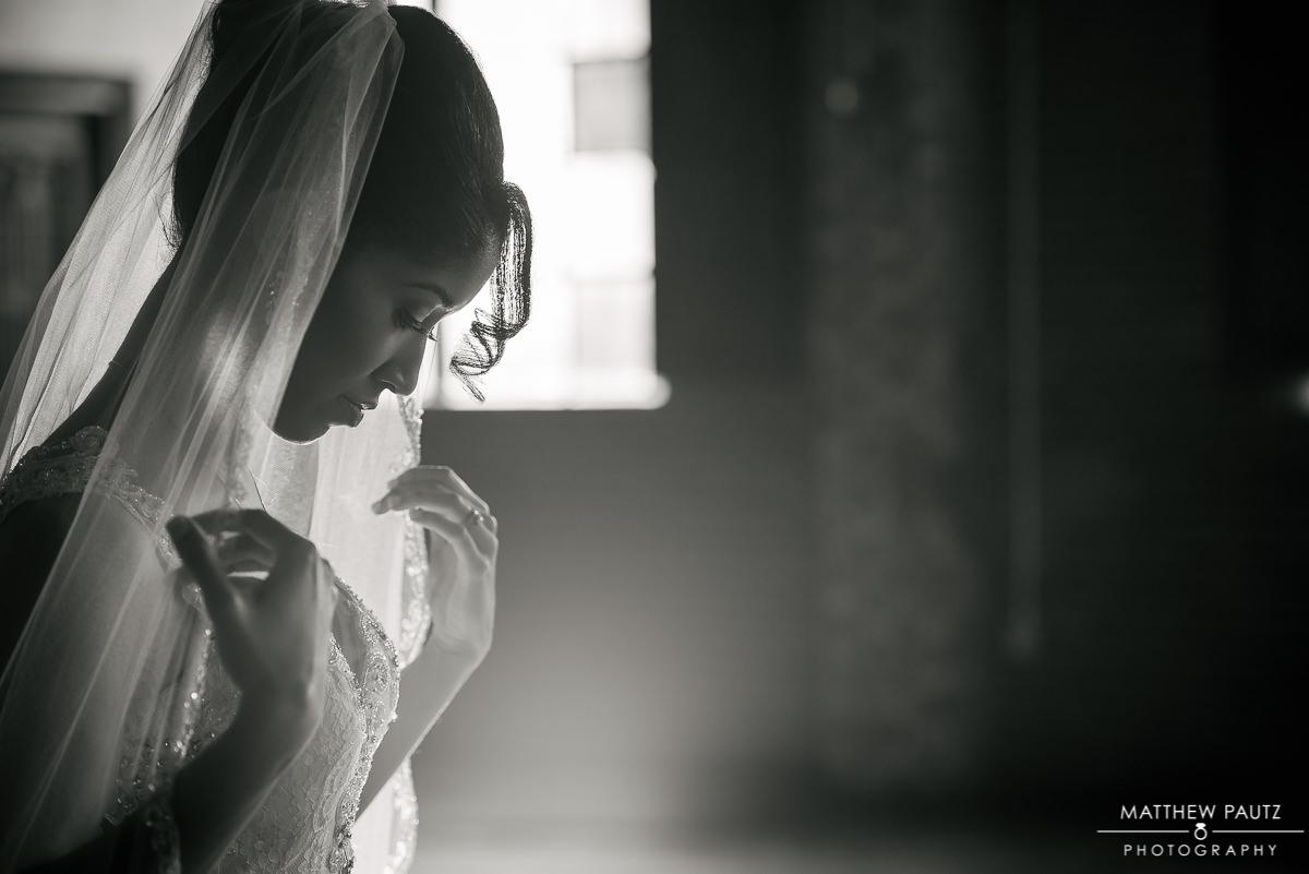bride adjusting her veil at Revel