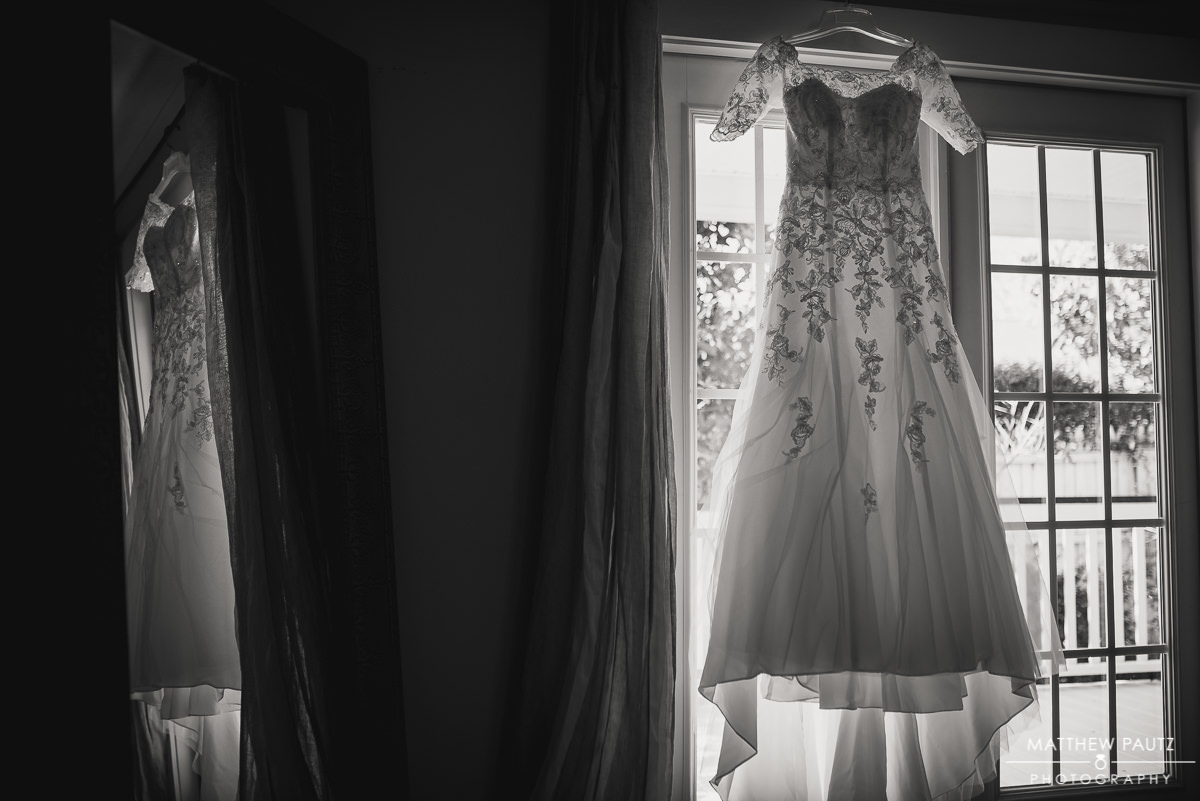 Wedding dress hanging in window at Twigs Tempietto