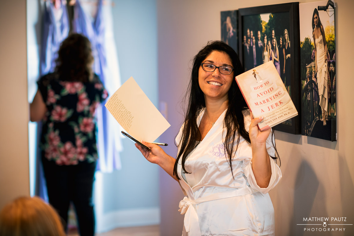 "bride holding up book ""how to not marry a jerk"""