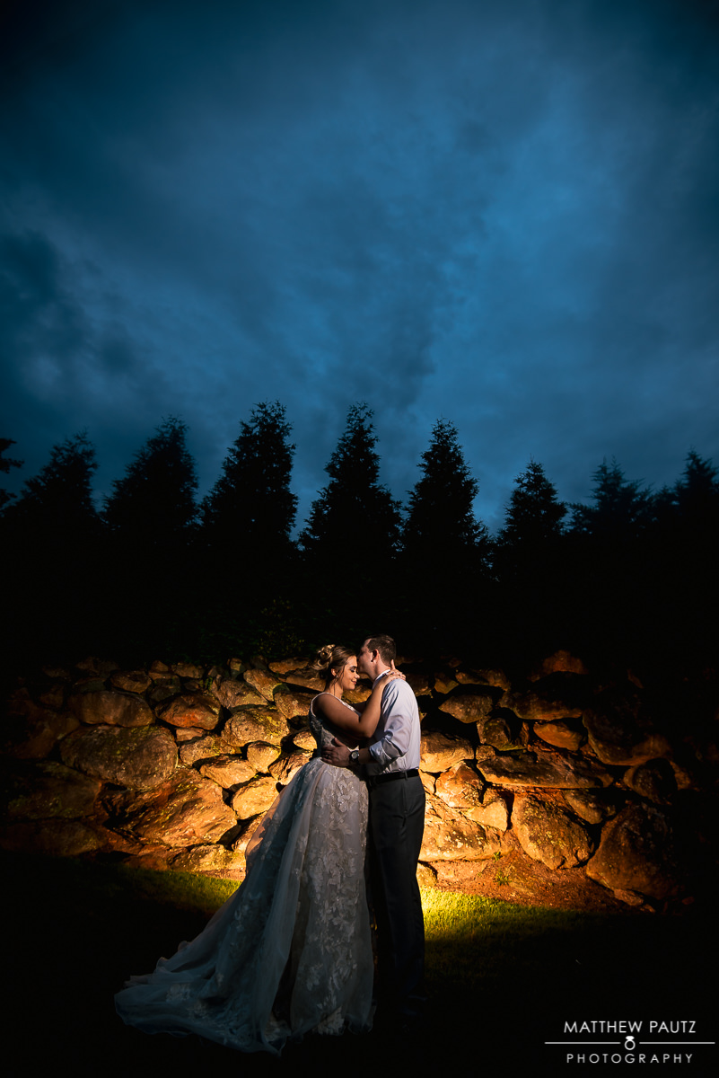 dramatic night photo of bride and groom kissing