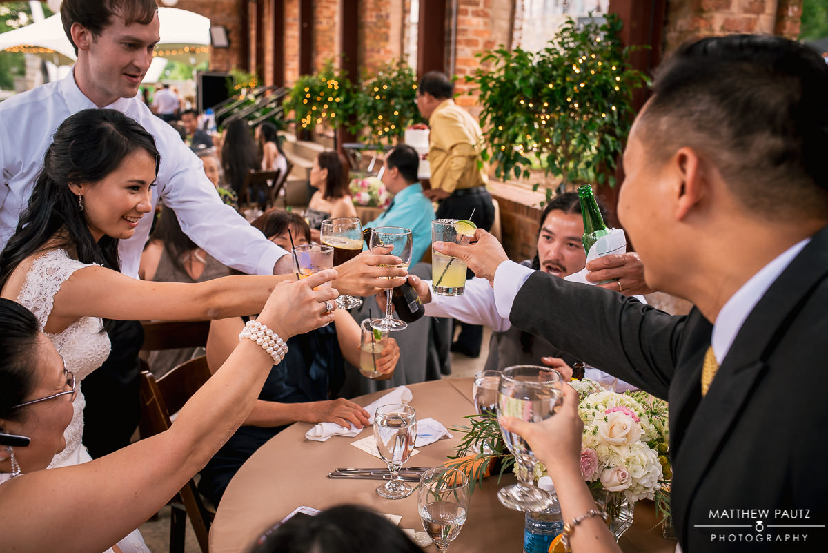 bride making toasts with table guests